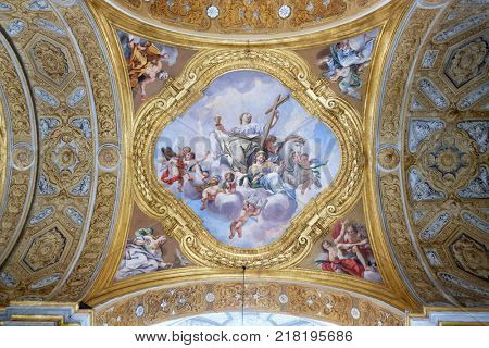 ROME, ITALY - SEPTEMBER 02: The fresco of virtues on the little cupola of side nave in Basilica dei Santi Ambrogio e Carlo al Corso by Pio Paolini from (1678 - 81), Rome, Italy on September 02, 2016.
