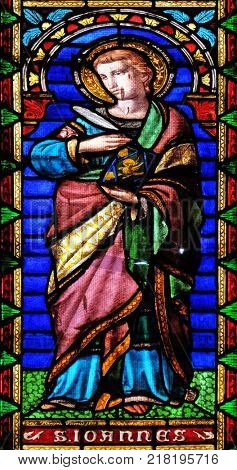 LUCCA, ITALY - JUNE 03: Saint John the Evangelist, stained glass window in the San Michele in Foro church in Lucca, Tuscany, Italy on June 03, 2017.