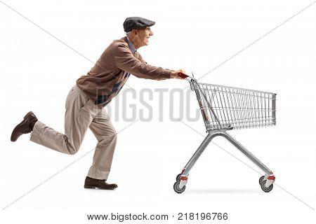 Senior running and pushing an empty shopping cart isolated on white background