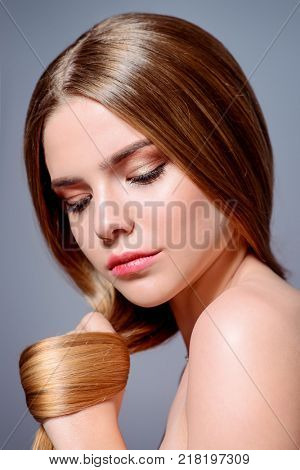 Beauty skin and hair concept. Portrait of a beautiful young woman with healthy shiny skin and hair.