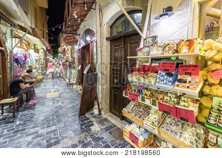 RETHYMNO CRETE - SEPTEMBER 20: Woman watching the merchandise in front of the shops at old town of city Rethymno on September 20 2017 in Crete
