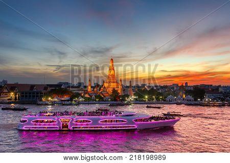 Wat Arun and cruise ship in twilight time Bangkok cityThailand