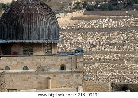 Al-Aqsa dome and Olive Mount cemetery on the background in Jerusalem Israel.