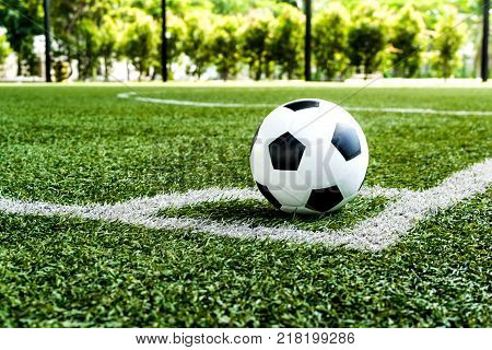 soccer Football on Corner kick line of ball and a soccer field football field background texture