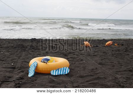 Ball swimming glasses sandal and Floating Ring on beach. Beach life-saving on sand beach. In the summer vacation. Beach life overcast