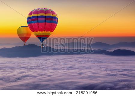 Aerial view from colorful hot air balloons flying over with the mist at Pha Tung mountain in sunrise time Chiang Rai Province Thailand