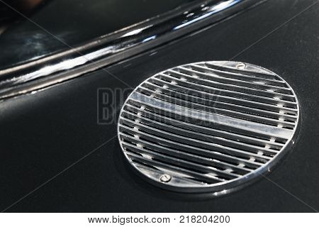 Air intake grille. Luxury vintage sports car fragment close up photo with selective soft focus