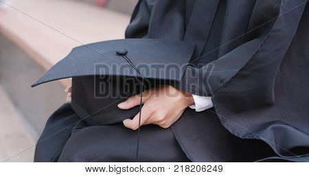 Woman wear graduation and holding mortarboard