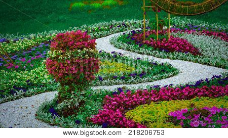 Flowerbed Japanese style, using annual multicolored flowers.