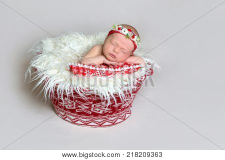 Newborn baby in santa claus bonnet