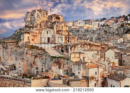 Matera, Basilicata, Italy: landscape at sunset of the old town (sassi di Matera) with the rock church Santa Maria de Idris