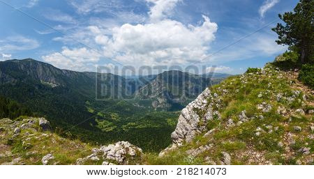 Panorama view from the heights to the mountains and picturesque canyon in Durmitor National Park, Montenegro