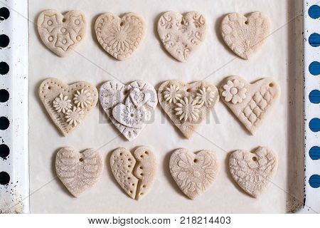 Making souvenirs from salty dough for Valentine's Day with your own hands. Art project handmade. DIY. Step-by-step photo instructions. Step 3. Drying hearts from salted dough