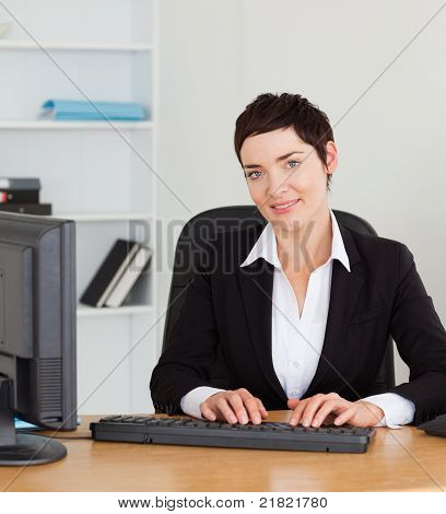 Portrait Of A Secretary Typing On Her Keybord