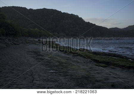INDONESIA: Scenery of Tanjung Papuma Beach with rock and mossy foreground. Papuma beach is located at Jember,Surabaya, East Java.