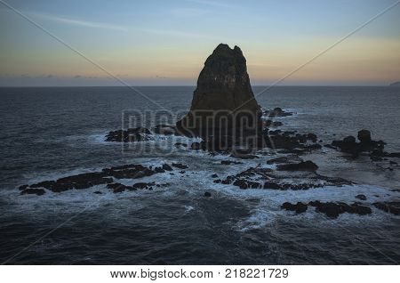 INDONESIA:Tanjung Papuma Beach is an amazing beach with the sunset view on the highest top. this beach is called as PAPUMA BEACH the abbreviation of pasir putih Malikan it located in Jember regency.
