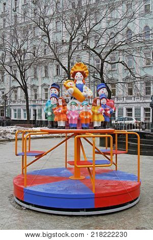 Moscow Russia - February 27 2017: Traditional Dymkovo toy Mother with children as art object and Children's carousel at Russian national festival