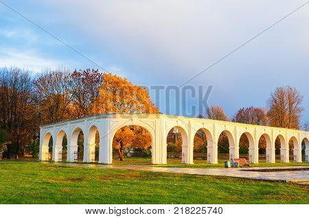 Veliky Novgorod Russia. Arcade of the medieval Yaroslav courtyardin sunny autumn day in Veliky Novgorod Russia. Autumn landscape of Veliky Novgorod Russia landmark