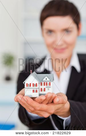 Businesswoman Holding A Miniature House