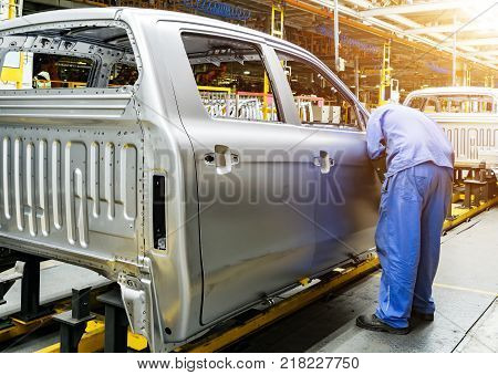 Car production line skilled workers are working tense.