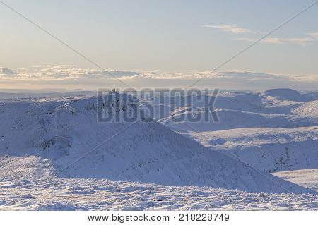 Winter snow scene from Pen y Fan mountain in the Brecon Beacons National Park, UK. A popular location for serious walkers and hikers with several routes to the summit.