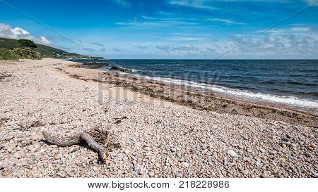 North Sea coastline, Sutherland, Scotland. A summer view of the pebble beach near the Highland town of Helmsdale by the North Sea in the north east of Scotland.