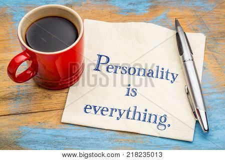 Personality is everything - handwriting on a napkin with a cup of coffee