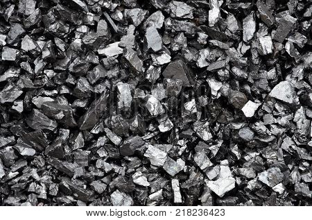 Washed and enriched coal anthracite, as a background.