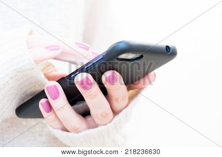 Closeup Image Of A Woman's Hands Holding And Using At Smart Phone. Soft Light, Selective Focus