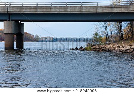 highway overpass above wisconsin river and hydroelectric dam in the distance