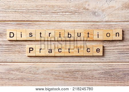 distribution practice word written on wood block. distribution practice text on table concept.