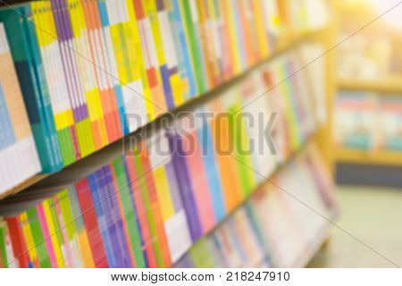 Abstract of blurred shelf in the book store for background : Concept business book shop.