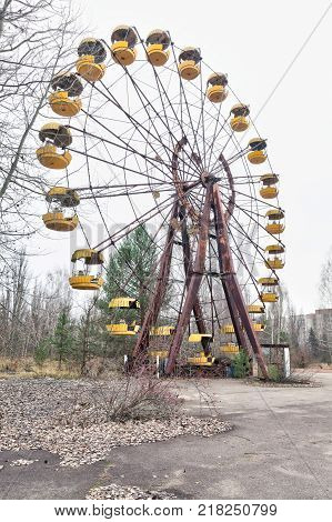 Attraction in amusement park in overgrown ghost city Pripyat near Chernobyl nuclear power plant in Ukraine.