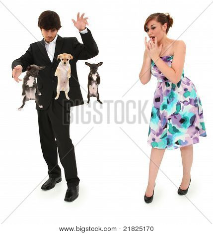 Teen boy impressing date by levitating puppies with magic. Clipping path over white background. poster