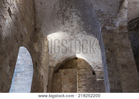Fragment of the remains of the walls of the inner halls in the ruins of the fortress in the old city of Acre in Israel