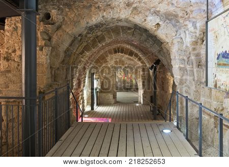 Acre Israel November 03 2017 : Fragment of the remains of the walls of the inner halls in the ruins of the fortress in the old city of Acre in Israel