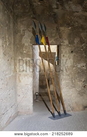 Acre Israel November 03 2017 : Three spears installed in one of the passages in the ruins of the fortress in the old city of Acre in Israel