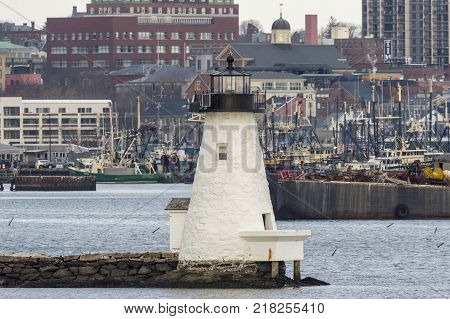New Bedford Massachusetts USA - December 11 2017: Palmer's Island lighthouse set against New Bedford waterfront backdrop