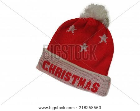 red hat with pompon and Christmas inscription on white background