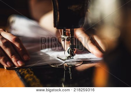 Sewing Machine And Woman's Hands
