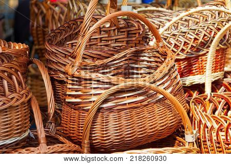 Wicker baskets made of straw.Handmade products for storage of food and stuff