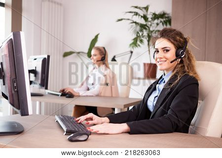 Telemarketing and call center support line. Women working at their desk