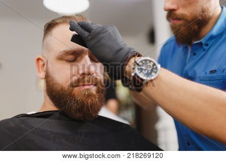 Male Professional Hairdresser Serving Client By Clipper. Ginger Handsome Brutal Stylish Young Man Wi