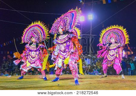 BAMNIA PURULIA WEST BENGAL INDIA - DECEMBER 23RD 2015 : Four dancers performing at Chhau Dance festival. It is a very popular Indian tribal martial dance performed at night amongst spectators.