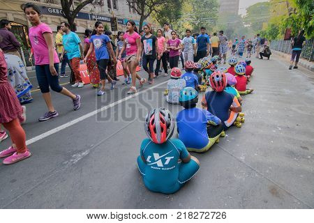 KOLKATA WEST BENGAL INDIA - MARCH 15TH 2015: Unidentified city children rollerskating on blocked otherwise busyPark Street for
