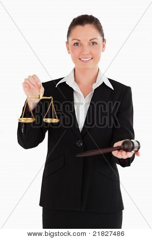 Good Looking Woman In Suit Holding Scales Of Justice And A Gavel