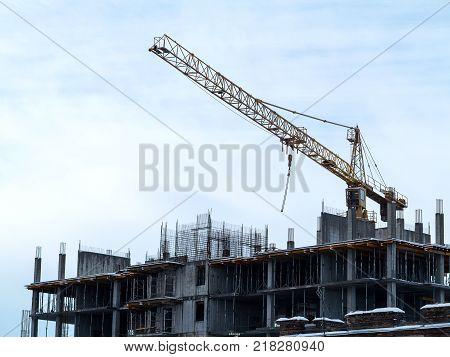 Sky Above Building Crane At Front Of A Multi-storey Uilding Under Construction, New House For Many F