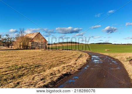 The muddy road in the countryside. Landscape of the Czech countryside. A sunny day on a farm