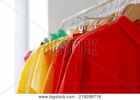 Rack with color clothes, close up