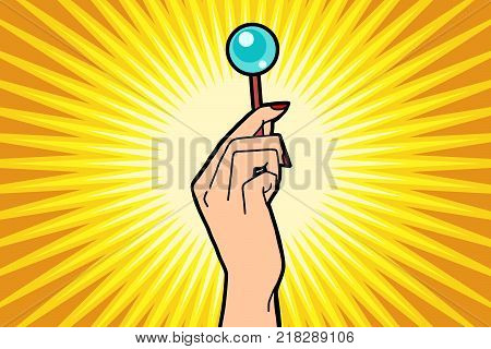 Lollipop in female hand. Comic book cartoon pop art retro color illustration drawing